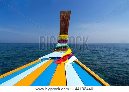 head of old thai boat on clear blue sky and sea