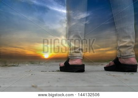 abstract double exposure between sunset time from view point and standing girl legs seascape background sea and sky so beautiful