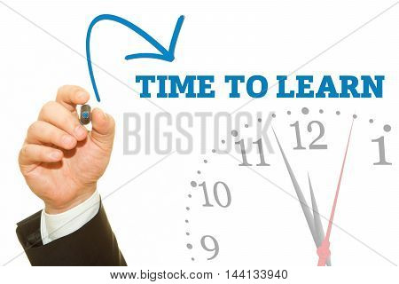Businessman hand writing TIME TO LEARN message on a transparent wipe board.