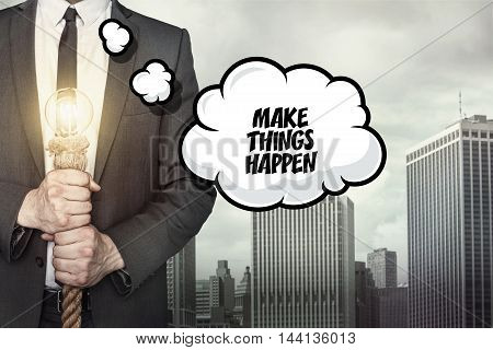 Make things happen text on speech bubble with businessman holding lamp