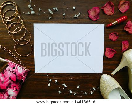 Glamorous composition made of woman`s accessories, lipstick and shoes