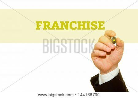 Businessman hand writing FRANCHISE word isolated on white.