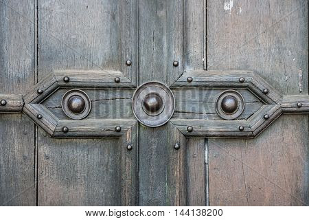 Fragment of an old wooden door of Saint Sernin Basilica in Toulouse, France.