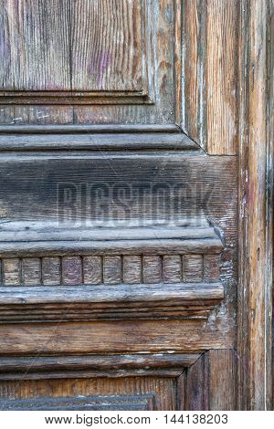 Fragment of an old wooden door in Toulouse, France.