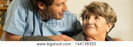 Covering Elderly Woman With Blanket