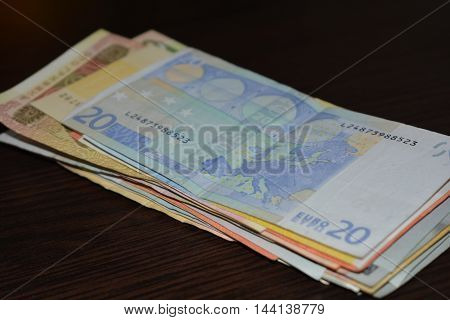 a stack of money lying on the table