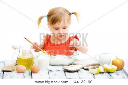 cute little baby girl baking isolated on a white background