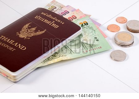 Thai Passport With Thai Money Banknote And Thai Coin Isolated On White. The Passport Of Thai Citizen