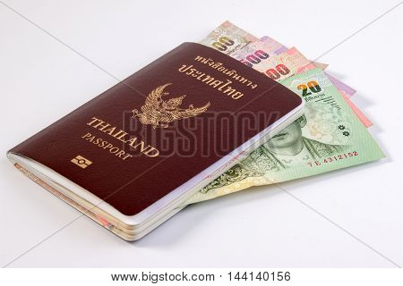Thai Passport With Thai Money Banknote Isolated On White. The Passport Of Thai Citizen On Thai Bankn