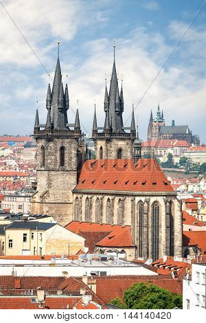 Aerial view of Tyn church in Prague old town and St. Vitus cathedral on background