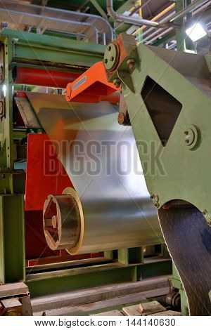 Metal coils machine in steel plant, close up