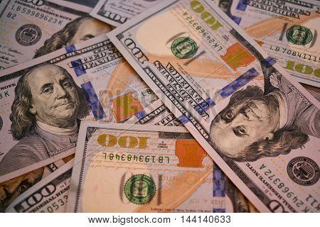 hundred dollar bills scattered on compete 100