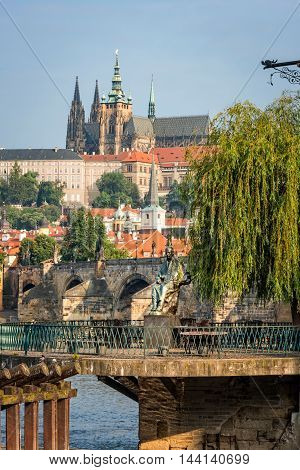 Prague Czech Republic - May 28 2016: Monument to composer Bedrich Smetana with St. Vitus Cathedral and Charles Bridge on background