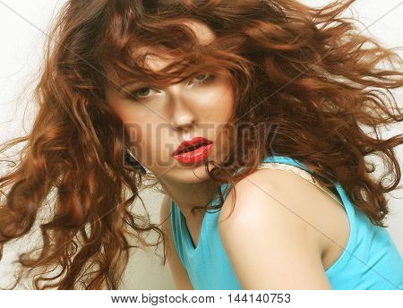 Young happy woman with curly hair