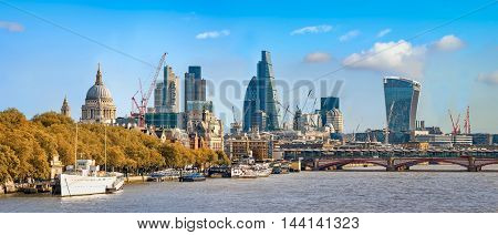 London United Kingdom - October 25 2015: Panoramic view of City of London as seen from Waterloo bridge. Copy space in sky.