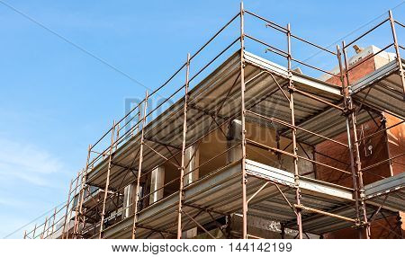 House For Renovation With The Scaffolding For Bricklayers