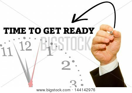 Businessman hand writing TIME TO GET READY message on a transparent wipe board.