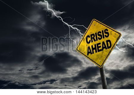3D rendering of Crisis Ahead sign against a stormy background with lightning and copy space. Dirty and angled sign adds to the drama. Concept of political financial social health crisis.