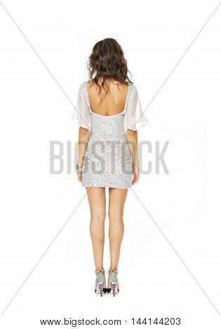Back view of a model in white dress isolated on white