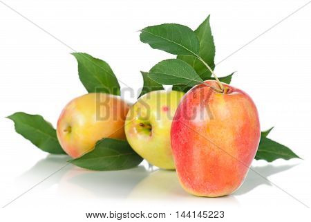 Ripe juicy apples with green leaves isolated on white background
