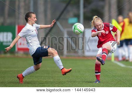 LINDABRUNN, AUSTRIA - APRIL 13, 2015: Siw Doevle (#10 Norway) and Anne Katrine Hansen (#17 Denmark) the ball during a UEFA women's U17 qualifying game.
