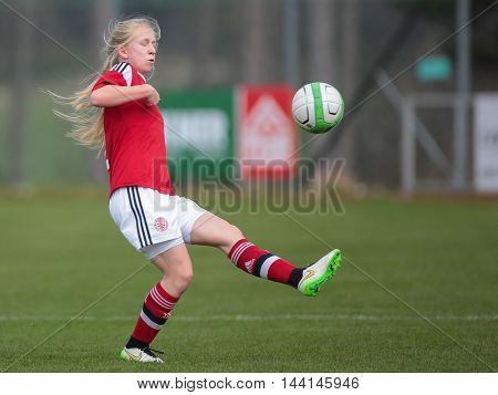 LINDABRUNN, AUSTRIA - APRIL 13, 2015: Laerke Tingleff (Denmark) kicks the ball during a UEFA women's U17 qualifying game.