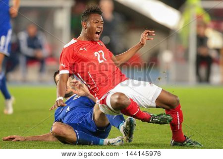 VIENNA, AUSTRIA - MARCH 31, 2015: David Alaba (#27 Austria) and Emir Spahic (#4 Bosnia-Herzegowina) fight for the ball during an European Championship qualifying game.