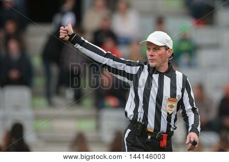 INNSBRUCK, AUSTRIA - APRIL 11, 2015: Head Referee Benny Lair signals during a game of the Big Six Football League.