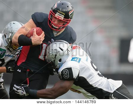 INNSBRUCK, AUSTRIA - APRIL 11, 2015: LB Wendel Brown (#9 Raiders) tackles QB Manuel Engelmann (#15 Panther) in a game of the Big Six Football League.