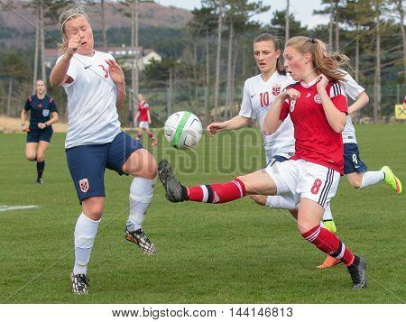 LINDABRUNN, AUSTRIA - APRIL 13, 2015: Julie Hansen (#8 Denmark) and Emma Andersen (#3 Norway) fight for the ball during a UEFA women's U17 qualifying game.