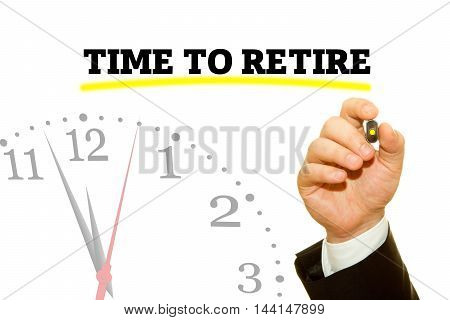 Businessman hand writing TIME TO RETIRE message on a transparent wipe board.