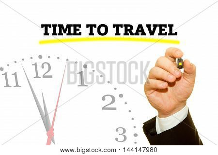 Businessman hand writing TIME TO TRAVEL message on a transparent wipe board.