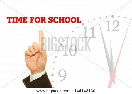 Businessman hand writing TIME FOR SCHOOL message on a transparent wipe board.
