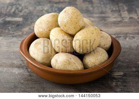 Canarian potatoes (papas arrugadas)  on wooden table