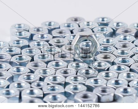 Bolts and screws on a white background. Bolts and screws used in construction. Tightening around the neck. Bolts and screws are descendants of mainly made of fine steel.