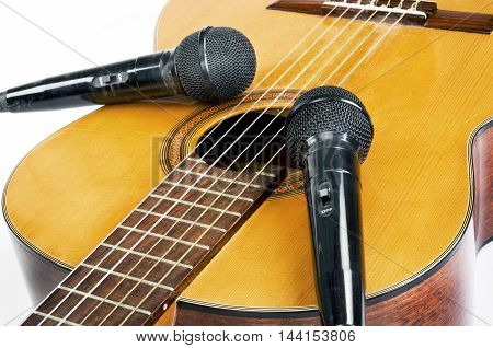 Record the music with microphones and acoustical guitar.