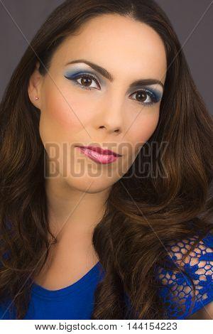 Beauty portrait about woman with blue makeup.