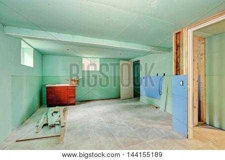 Basement Renovation. Mint Green Walls And Tile Floor