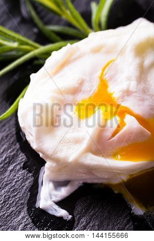 Detail Of Single Poached Egg On Slate Stone