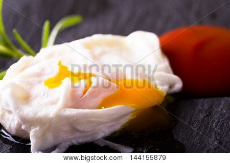 Single Poached Egg On Slate Stone With Ketchup
