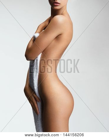 Silhouette of slender naked girl. Photo of woman body with perfect skin. Wellness and Spa concept