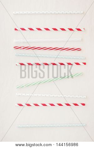 Drinking straws background. Set of different drinking straws over white background.  Top view, blank space