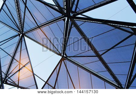 The digitized image is a fragment of the roof and the ceiling with a triangular pattern on the entire structure of the surface mesh