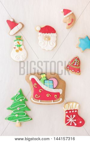 Holiday gingerbread cookies decorated with royal icing, top view