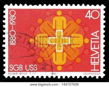 SWITZERLAND - CIRCA 1980 : Cancelled postage stamp printed by Switzerland, that shows people figures.