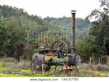 An old steam engine machine in the country