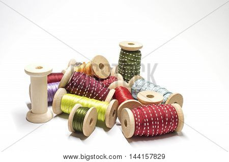 Wooden spools with ribbons in several colors