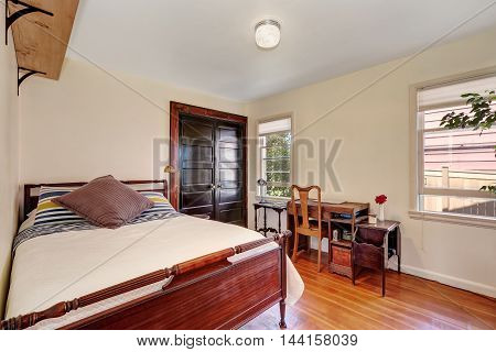 Interior Of Small White Bedroom With Vintage Desk