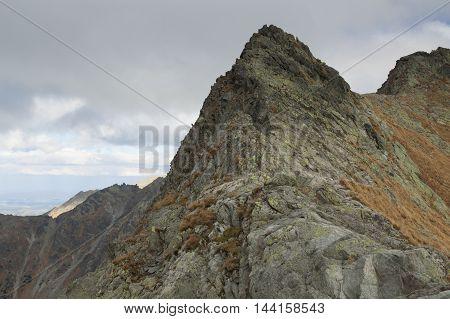 Poland/Slovakia Tatra Mountains slopes of Swinica peak seen from north fall overcast sky