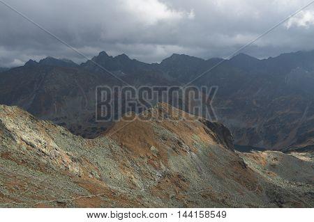 Poland Tatra Mountains Tatry Wysokie Kolowa Czuba peak foreground seen form Zawrat Dolina Pieciu Stawow background